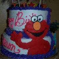 Two Sided Cake- Better Look At Elmo   if you look at the arm you will see that my daughter got a little excited and broke it but i think it looks okay