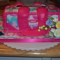 Coach Purse   all made of buttercrm flowers are gumpaste