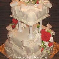 Ribbon And Bows Wedding Cake