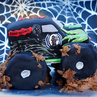 Gravedigger Monster Truck Hand carved, fondant covered. Fondant covered bagels for wheels.