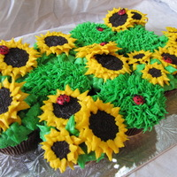 Sunflower Cupcakes Sandwich cookie sunflowers and candy coated chocolate ladybugs.