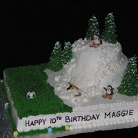 Soccer And Skiing Birthday Cake The birthday girl loves to play soccer and ski. So I combined them both in this fun cake! Royal icing penguins, fondant soccer ball and...