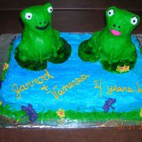 Frogs Cake I used the little bear pan for the frogs and covered in buttercream.