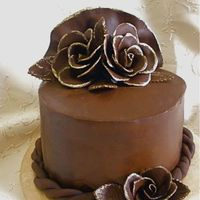 Chocolate Chocolate cake with whipped ganache filling and poured ganache on the outside. It was my first time covering a cake in ganache. The roses...