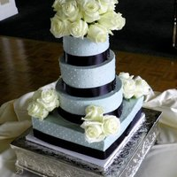 Grey With Swiss Dots Grey buttercream with swiss dots. Fresh flowers. It's 12, 10, 8, 6.