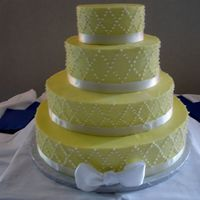 Yellow And White Diamonds All buttercream with satin ribbon. 16, 12, 9 and 6. Bride brought me a photo of something similar.