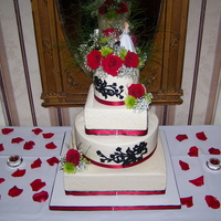 Red & Black Wedding Cake Tier's are 6,8,12 & 14. Chocolate cake w/ whipped choc ganache & Vanilla w/ white chocolate cream, Buttercream icing. Used my...