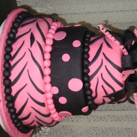 Pink And Black Zebra Stripe Party Cake Three tiered Zebra striped theme cake I did for a young woman's birthday..