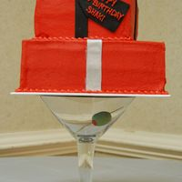 Martini Glass Gift Boxes  2-tier gift boxes iced in red buttercream with fondant ribbons and bow. Cake was set atop a giant martini glass with a fondant olive inside...