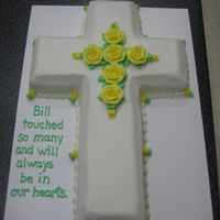 Cross Cake   Cross was cut from a 12x18 sheet cake and edges beveled. Simple flowers to accent. Cake was for a memorial service.