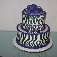 "Zebra Print   6"" and 9"" tiers with zebra print edible image around the sides."