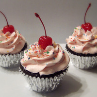Cherry Cordial Cupcake  These are cupcakes I make for the farmers markets in my area. This one is cherry cordial which is a chocolate fudge cake topped with...