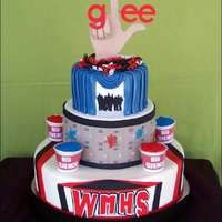Glee Cake Covered in fondant with cupcakes in the slushie cups. The glee logo and hand were gumpaste and the logo, WMHS letters, and silhouette was...