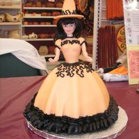Halloween Witch Wonder Mold Cake I made this for a Halloween-themed demo at my store. I used the Wilton wonder mold, and made the doll into a witch instead of the standard...