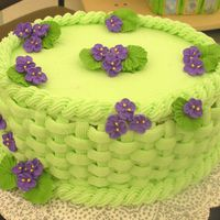Green Basketweave Cake W/violets I made this cake at a demo for my store. One just like it was featured on the cover of our class catalog, so I reproduced it at the demo....