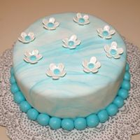 Teal Themed Fondant Cake Marbelized fondant covered cake, team theme, fondant flowers brushed with pearl dust.