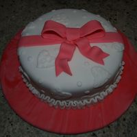Valentine's Day Cake The cake and cake board are covered in fondant. The cake is covered in fondant overlays & fondant bow.