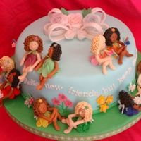 Brownie Girl Scout Troop Cake  I made this for my GS Troop last year. Each fairy represents a part of the of the Girl Scout Law(we had previously made pony bead bracelets...