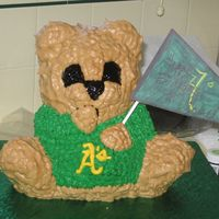 Oakland A's 3-D Teddy   I made this cake for a friedn who works in Diamond level as a Server for one of his regular customers.