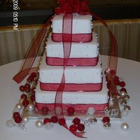 Christmas Square Fondant Wedding Cake 4 Tier Square wedding cake made with cream cheese buttercream and fondant. Stars made out of gumpaste and dragees with pearl dust. Red silk...