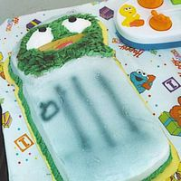 Ocsar The Grouch I did not think this cake would turn out but it turned out to be my favorite of the 4 cakes. I used tip 48 for his face, hands and the...
