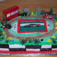 Nascar Theme  This cake was a project! My customer wanted a picture of Kasey Khane's car which I can d obut the local cake store that has the edible...