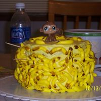 Ashley's Monkies my attempt at a monkey with bananas cake. the bananas kept falling off of the sides of the cake.