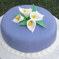 Calla Lily And Fondant Covered in purple fondant. Calla Lily and leaves from gum paste.