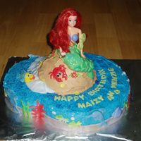 "Mermaid Cake vanilla cake with buttercream and fondant decorations. it was (2) 12"" rounds, 1 wilton doll cake pan with doll pick, i swapped out the..."
