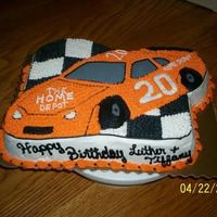 Just Another Racecar Cake strawberry cake, buttercream icing