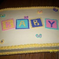 Baby Blocks And Booties just a half sheet cake with buttercream icing