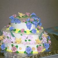 Spring Explosion Cake Bride requested the cake look like a spring garden, sugarpaste flowers