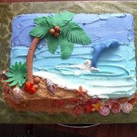 "Casey's 5Th Cake  We had just gotten back from the carribiean and DS says,""Mom, I want an ocean cake with a dolphin jumping, seashells, a palm tree and..."
