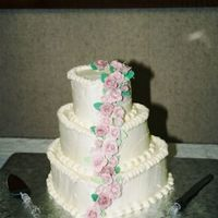 Maria's Cake Young bride wanted something simple and romantic, sugarpaste roses cascade down heart shaped cakes