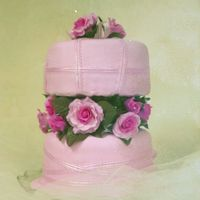 Mish's40Th Surprise   Lightly marbled pink fondant with sugarpaste roses and pink ribbons,