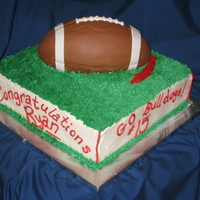 Football Graduation  This cake was made for Fresno State Football Star Ryan Colburn! My first cake for someone famous! :D (His Aunt is a friend) The football is...
