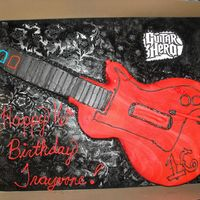 Guitar Hero  My nephew's 16th bday party cake. I cwas very happy to do this. It was my first time making and using fondant. I cut it from a half...