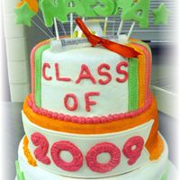 Class Of 2009  This is a 2layer 3 tier yellow batter cake. I made marshmallow fondant and used it for the accent pieces. I used butter cream for the bace...