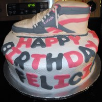 Reebok Shoe   This is the cake I did for my daughter's 6th birthday. Her favorite shoe! Yellow cake, buttercream, and mmf