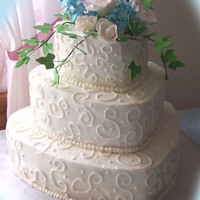3 Tier Hearts   3 Tier wedding heart cake. Flowers and ivy made out of gumpaste.