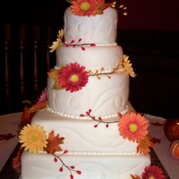 Gerber Daisy Wedding Cake This cake was for my sister who was married 5 hours away so i had to travel with it in pieces and assemble when we got there. covered in...