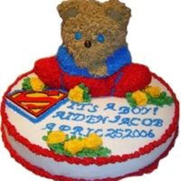 Super Bear! I made this cake for my friend's new baby boy. His father was a huge Superman fan. You can't see it in this picture, but the bear...