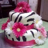 Zebra Print With Hot Pink Ribbon & Daisies  This was to match the zebra print and hot pink accents on the bridal shower. They were using daisies to dress up the tables. This was a LOT...