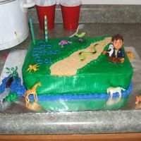 Go Ethan Go! My son's 2nd birthday cake. 2 layer white and chocolate with BC. Diego and animals are toys.