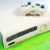 Xbox 360 Cake Grooms Cake-- all fondant. The controller we made out of rice crispy treats. My brother has a real Xbox 360-he lent it to us so we could...