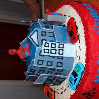 Spiderman For My God Sons Birthday.. the town is color flow icing hevery one just loved this cake. i 'm puting up more pick.