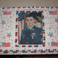 Fallen Hero This cake was made in honor of my cousin in law who died in Iraq. His picture was placed on edible paper, the flags are made from sugar, i...