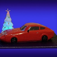 "Car Cake: 1970 Datsun 240Z  This is my first car cake, for a car clubs' Christmas party; it is 24"" . After completeing this I bow down to all those before me..."