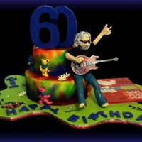 "Grateful Dead/jerry Garcia Dead Head fan turned 60. His wife was a Phish fan so I had to pay tribute (""All fondant and candy clay."