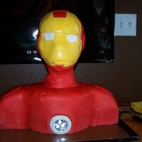 Iron Man  3D Iron Man cake, for my son's 5th bday. I used the same directions as the 3D Spider Man cake, Thanks! The light in his chest, is a...